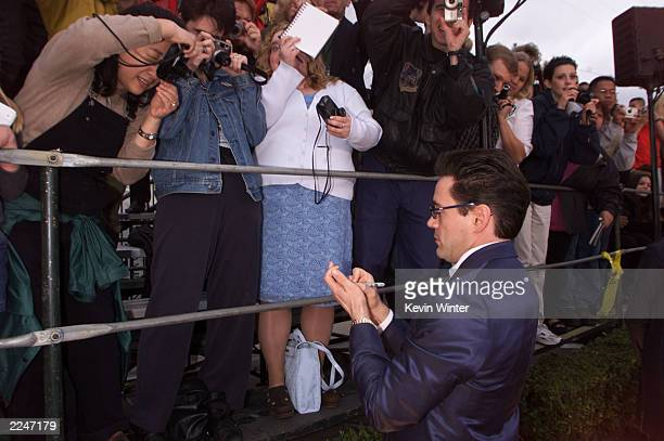 Robert Downey Jr arrives at the 7th Annual Screen Actors Guild Awards held at the Shrine Auditorium Los Angeles CA March 2001