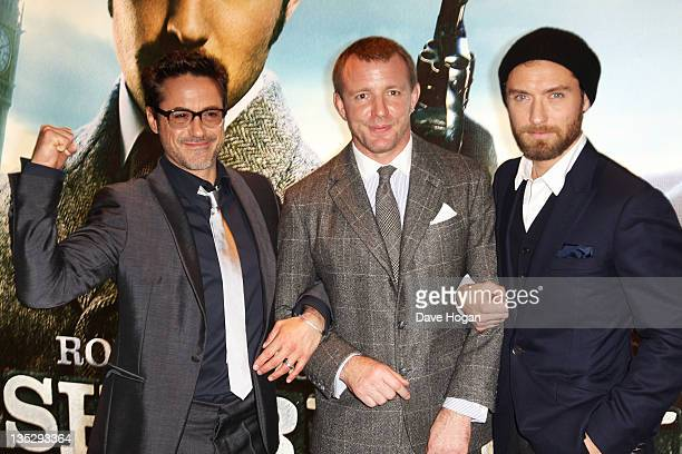 Robert Downey Jr Guy Ritchie and Jude Law attend the European premiere of Sherlock Holmes A Game Of Shadows at The Empire Leicester Square on...