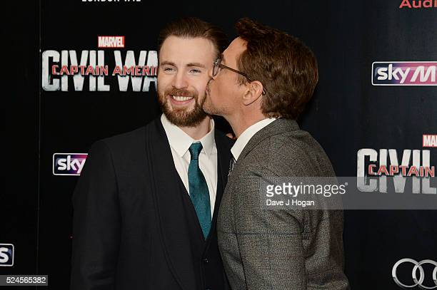"Robert Downey Jr. Kisses Chris Evans during the European film premiere of ""Captain America: Civil War"" at Vue Westfield on April 26, 2016 in London,..."