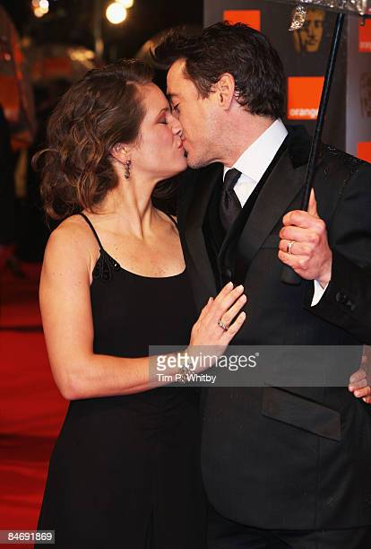 Robert Downey Jr kisses his wife as they arrive for the Orange British Academy Film Awards 2009 at the Royal Opera House on February 8 2009 in London...