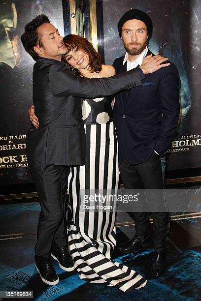 Robert Downey Jr Noomi Rapace and Jude Law attend the European premiere of Sherlock Holmes A Game Of Shadows at The Empire Leicester Square on...