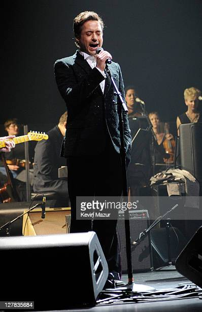 Robert Downey Jr performs on stage during STING: 25th Anniversary/60th Birthday Concert to Benefit Robin Hood Foundation at Beacon Theatre on October...