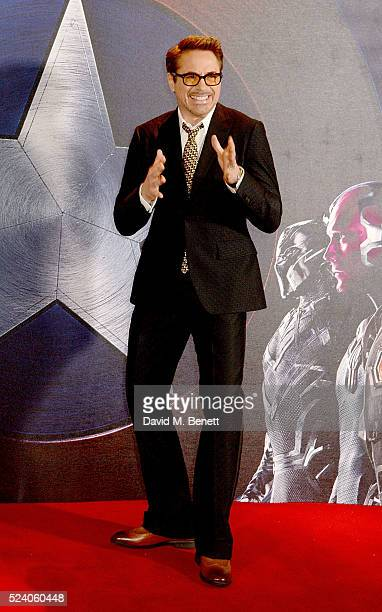 Robert Downey Jr poses at a photocall for 'Captain America Civil War' at The Corinthia Hotel London on April 25 2016 in London England