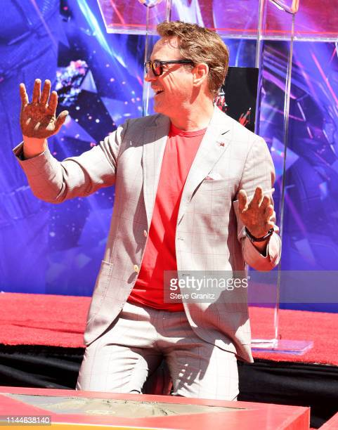 """Robert Downey Jr. Poses at the Marvel Studios' """"Avengers: Endgame"""" Cast Place Their Hand Prints In Cement At TCL Chinese Theatre IMAX Forecourt at..."""