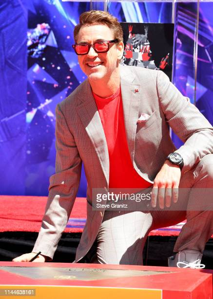 Robert Downey Jr poses at the Marvel Studios' Avengers Endgame Cast Place Their Hand Prints In Cement At TCL Chinese Theatre IMAX Forecourt at TCL...