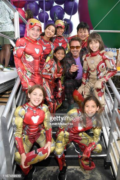 Robert Downey Jr. Poses with performers in cosplay during FOX's Teen Choice Awards 2019 on August 11, 2019 in Hermosa Beach, California.