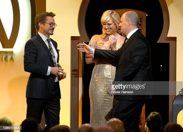 Robert Downey Jr presents the David O Selznick Film Award to Kevin Feige onstage during the 30th annual Producers Guild Awards at The Beverly Hilton...