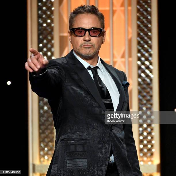 Robert Downey Jr presents the Hollywood Breakthrough Screenwriter Award onstage during the 23rd Annual Hollywood Film Awards at The Beverly Hilton...