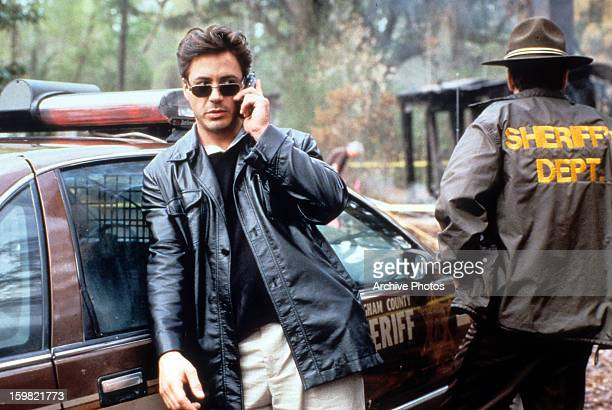 Robert Downey Jr talks on a phone in a scene from the film 'The Gingerbread Man' 1998