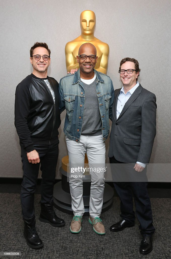 Robert Downey Jr. (L) with director David Dobkin (R) and Patrick Harrison, Program Director at Academy of Motion Picture Arts and Sciences arrive for the official Academy Members Screening of 'The Judge' hosted by The Academy Of Motion Picture Arts And Sciences at the Academy Theater at Lighthouse International on October 7, 2014 in New York City.