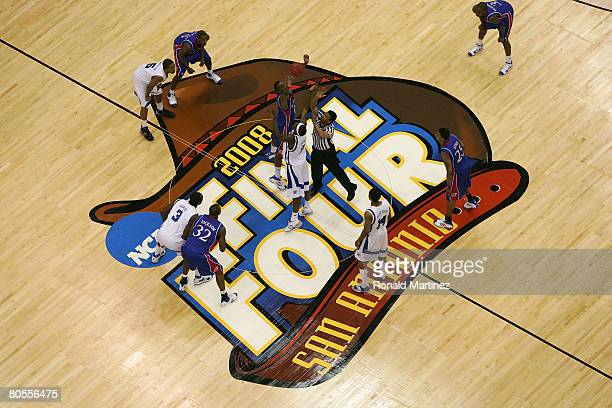 Robert Dozier of the Memphis Tigers and Darrell Arthur of the Kansas Jayhawks both jump for the tipoff to start the first half during the 2008 NCAA...