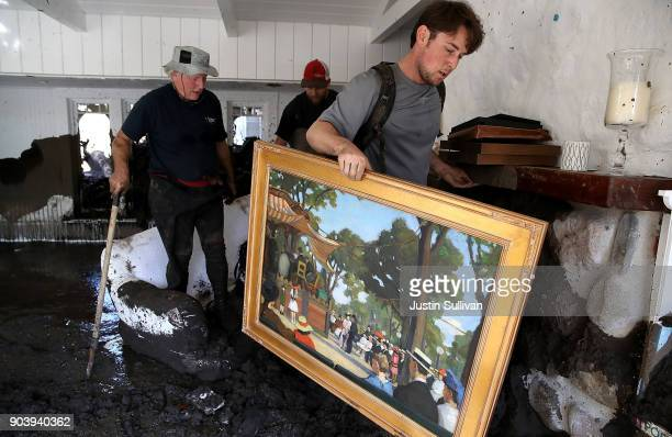 Robert Drenic carries a painting the home of a family member that was destroyed by a mudslide on January 11 2018 in Montecito California 17 people...