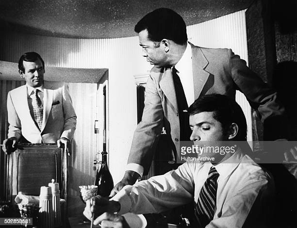 Robert Drivas gives instructions to Vince Howard as David Janssen looks on in a scene for the United Artist movie Where It's At circa 1968