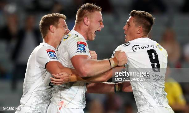 TOPSHOT Robert du Preez JeanLuc du Preez and Louis Schreuber of the Sharks celebrates a try during the Super Rugby match between the Auckland Blues...