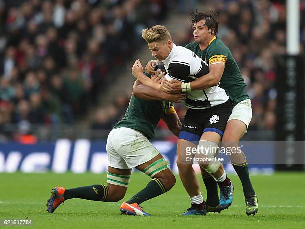 Robert Du Preez of Barbarians takes on Nizaam Carr and Francois Venter of South Africa during the Killik Cup match between Barbarians and South...