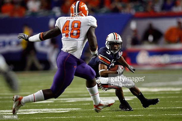 Robert Dunn of the Auburn University Tigers runs against Jeremy Campbell of the Clemson Univeristy Tigers during the ChickFilA Bowl on December 31...