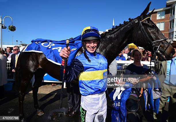 Robert Dunn with his ride Wayward Prince celebrates in the paddock after winning the Coral Scottish Grand National Handicap Chase on the second day...
