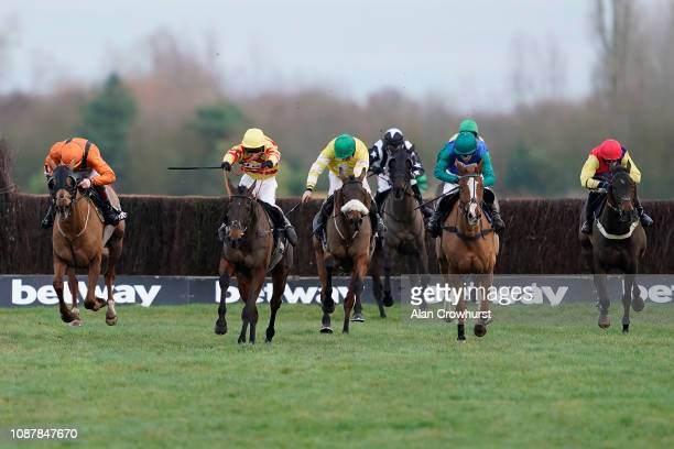 Robert Dunne riding Carole's Destrier squeeze up the inside to win The Betway Mandarin Handicap Chase at Newbury Racecourse on December 29 2018 in...
