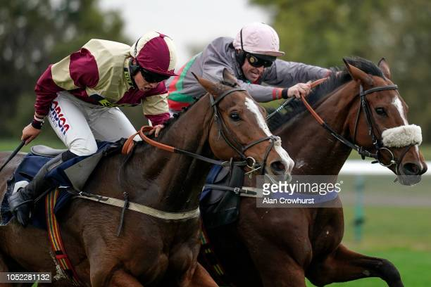 Robert Dunne riding Snapdragon Fire clear the last to win The Molson Coors Handicap Hurdle at Huntingdon Racecourse on October 16 2018 in Huntingdon...