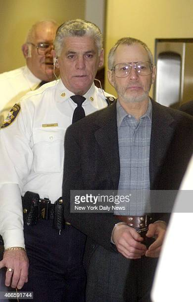 Robert Durst is escorted in handcuffs through the Northampton court house in Easton Penn Durst is a suspect in his wife's disappearance 19 years ago...