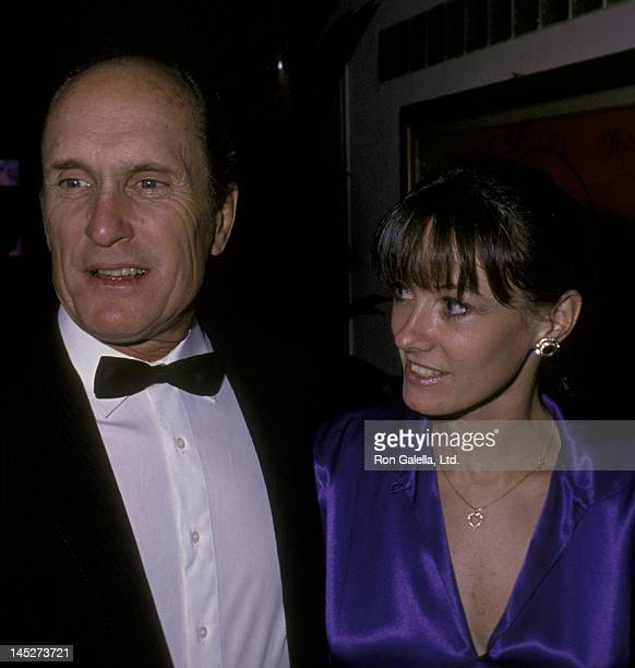 Robert Duvall and wife Sharon Brophy attend the premiere party for Full Moon In Blue Water on November 2 1988 at Peter Max Studio in New York City