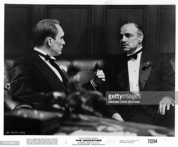 Robert Duvall having a conversation with Marlon Brando in a scene from the film 'The Godfather' 1972