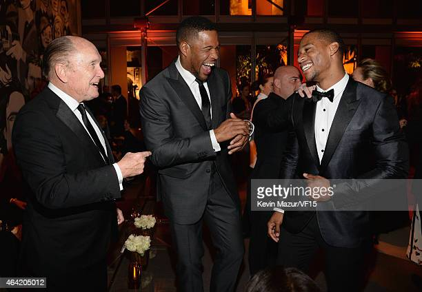 Robert Duvall Victor Cruz and Michael Strahan attend the 2015 Vanity Fair Oscar Party hosted by Graydon Carter at the Wallis Annenberg Center for the...