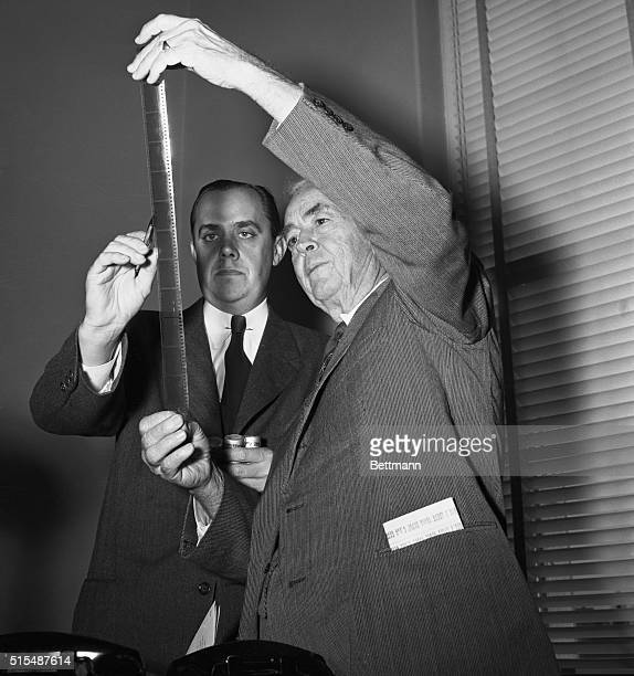 Robert E Stripling Chief Investigator of the House UnAmerican Committee and Representative John Rankin Committee member inspect some of the hundreds...