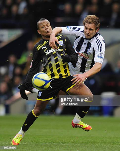 Robert Earnshaw of Cardiff City is challenged by Craig Dawson of West Bromwich Albion during the FA Cup Third Round match between West Bromwich...