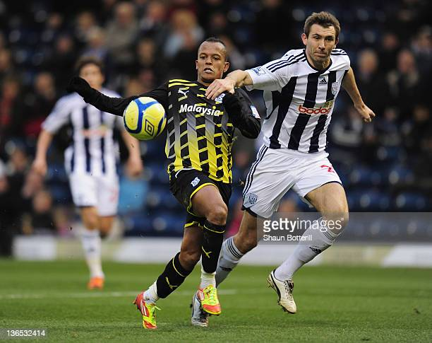 Robert Earnshaw of Cardiff City is challenged by Gareth McAuley of West Bromwich Albion during the FA Cup Third Round match between West Bromwich...