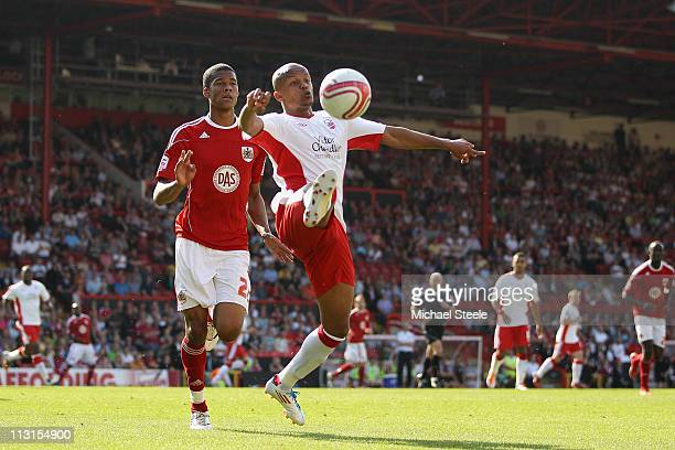 Robert Earnshaw of Forest traps the ball as Jordan Spence closes in during the npower Championship game between Bristol City and Nottingham Forest at...