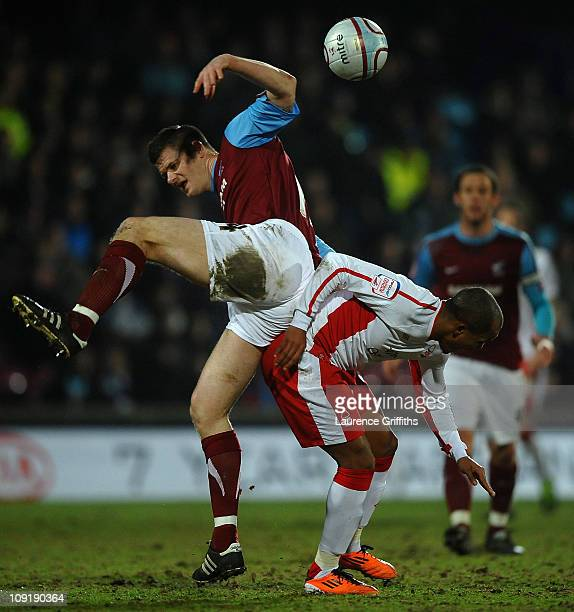 Robert Earnshaw of Nottingham Forest battles for the ball with Michael Nelson of Scunthorpe United during the npower Championship match between...