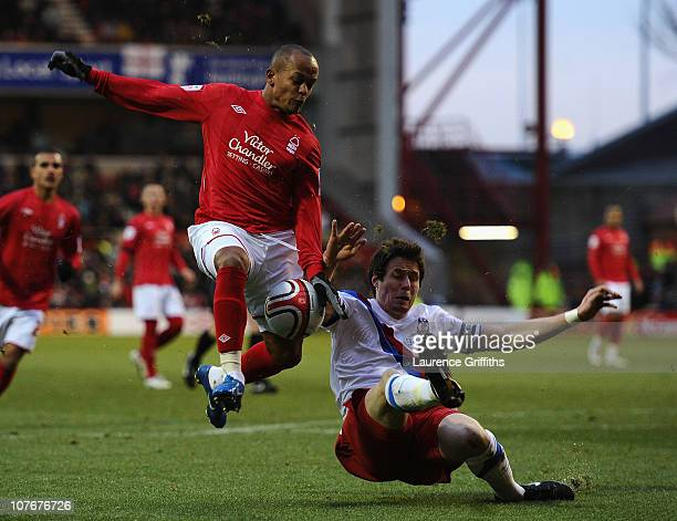 Robert Earnshaw of Nottingham Forest battles with Patrick McCarthy of Crystal Palace during the npower Championship match between Nottingham Forest...