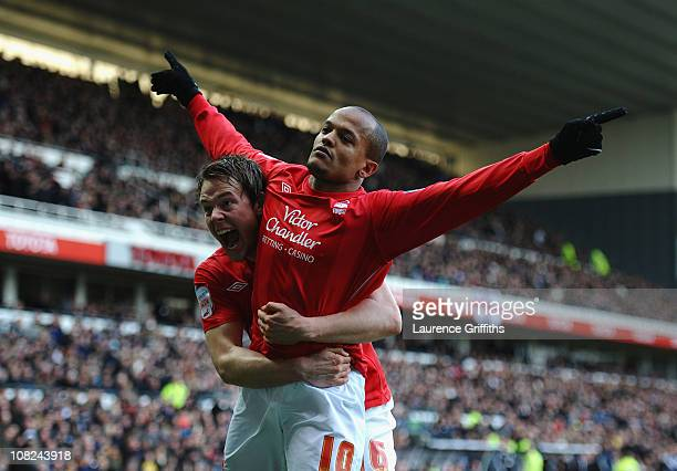 Robert Earnshaw of Nottingham Forest celebrates with Chris Gunter during the npower Championship match between Derby County and Nottingham Forest at...