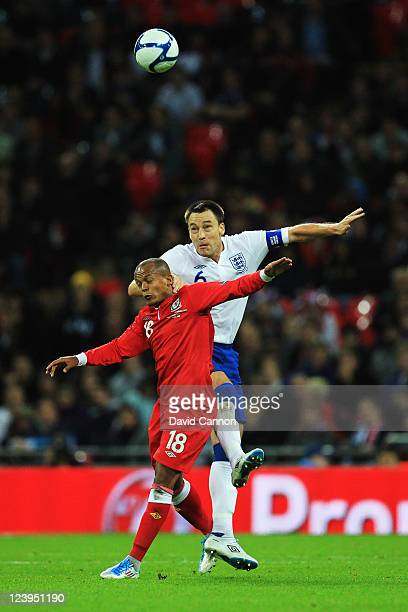 Robert Earnshaw of Wales and John Terry of England challenge for the ball during the UEFA EURO 2012 group G qualifying match between England and...