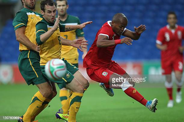 Robert Earnshaw of Wales hurdles a challenge from Luke Wilkshire of Australia during the International Friendly match between Wales and Australia at...