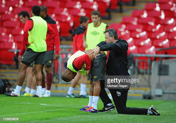 Robert Earnshaw receives treatment during the Wales training session ahead of their UEFA EURO 2012 Group G qualifier against England at Wembley...