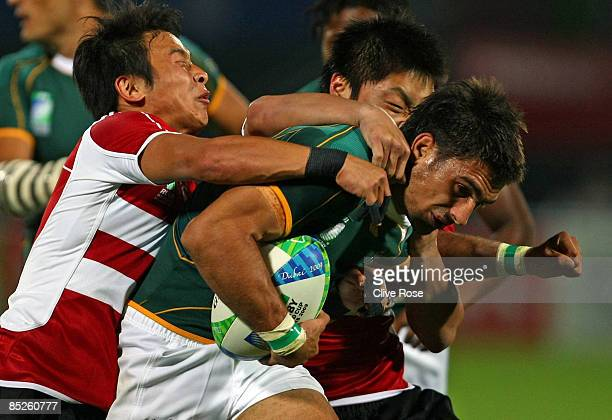 Robert Ebersohn of South Africa is tackled during the Pool C match between South Africa and Japan at the IRB Rugby World Cup Sevens 2009 at The...