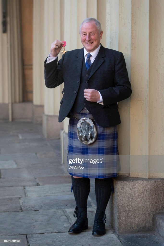 Robert Edwards with his OBE at Buckingham Palace on December