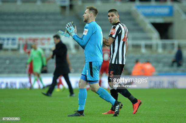 Robert Elliot and Aleksandar Mitrovic of Newcastle United show appreciation to the fans following during the Premier League match between Newcastle...