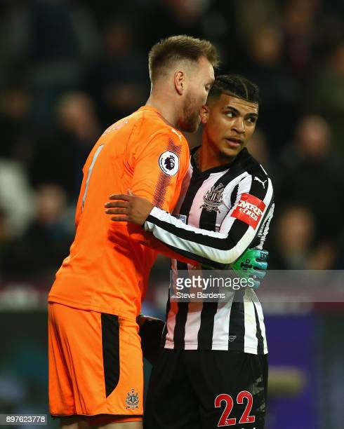 Robert Elliot of Newcastle United and Deandre Yedlin of Newcastle United celebrate after Robert Elliot saves a penalty during the Premier League...