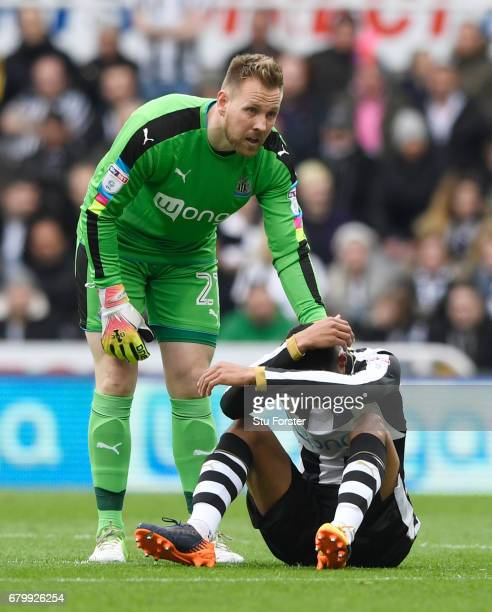 Robert Elliot of Newcastle United checks is Isaac Hayden of Newcastle United is okay after he goes down injured during the Sky Bet Championship match...