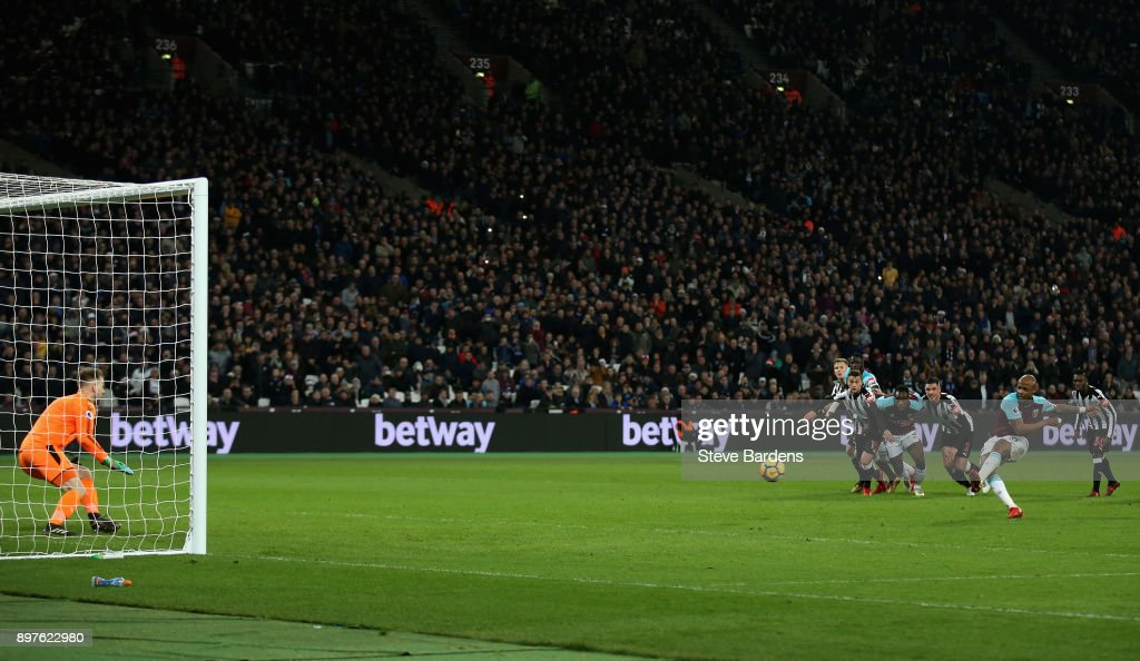 Robert Elliot of Newcastle United saves a penlty from Andre Ayew of West Ham United during the Premier League match between West Ham United and Newcastle United at London Stadium on December 23, 2017 in London, England.