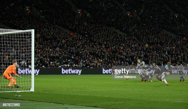 Robert Elliot of Newcastle United saves a penlty from Andre Ayew of West Ham United during the Premier League match between West Ham United and...