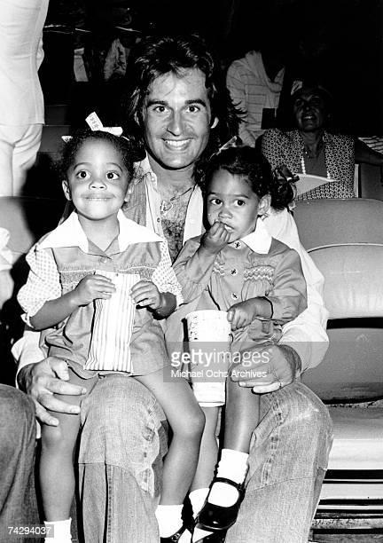 Robert Ellis Silberstein aka Bob Ellis attends a movie with daughters Rhonda Suzanne Silberstein and Tracee Joy Silberstein circa 1975 in Los Angeles...