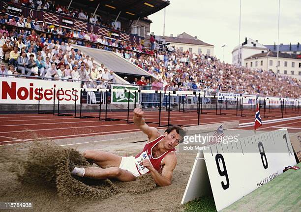 Robert Emmiyan lands in the sand pit after his long jump during the IAAF Mobil 1 Grand Prix at the Bislett Games on 4th July 1987 at the Bislett...