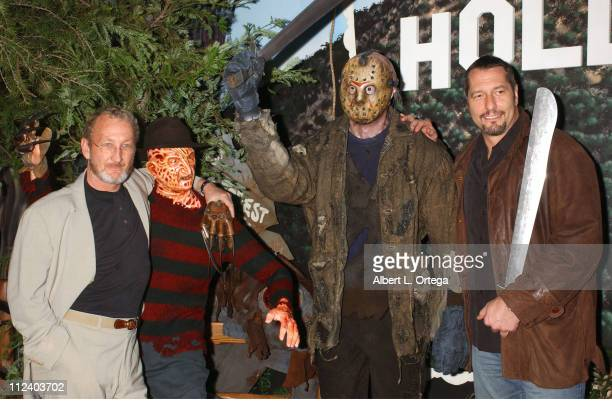 Robert Englund and Ken Kirzinger pose with their wax likeness of Freddy Krueger and Jason Voorhees