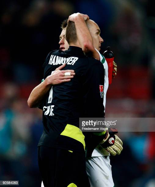 Robert Enke and Hanno Balitsch of Hannover celebrate after winning the Bundesliga match between 1 FC Koeln and Hannover 96 at the Rhein Energie...