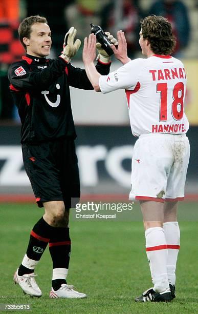 Robert Enke and Michael Tarnat of Hanover celebrate the 10 victory of the Bundesliga match between Bayer Leverkusen and Hanover 96 at the BayArena on...