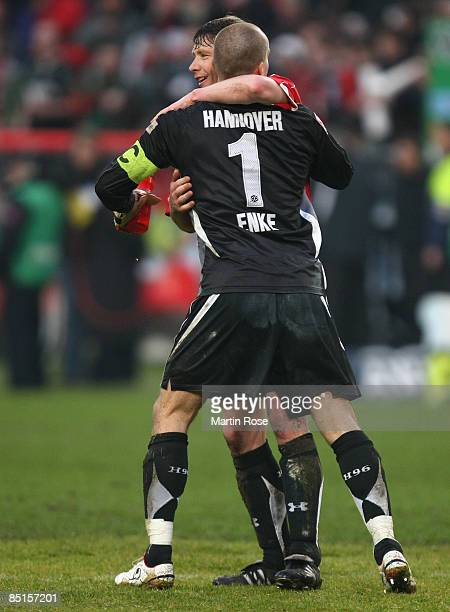 Robert Enke goalkeeper of Hannover 96 celebrates with team mate Michael Tarnat after the Bundesliga match between Hannover 96 and Bayer Leverkusen at...